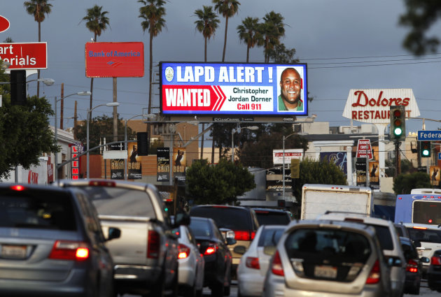A digital billboard along Santa Monica Boulevard on the west side of Los Angeles shows a &quot;wanted&quot; alert for former Los Angeles police officer Christopher Dorner Friday, Feb. 8, 2013.  Dorner is suspec