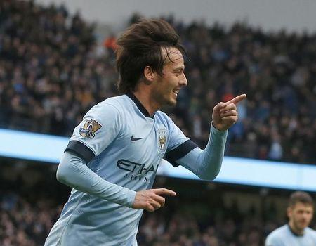 Manchester City's David Silva celebrates after scoring his second goal against Crystal Palace during their English Premier League soccer match at the Etihad Stadium in Manchester