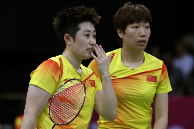 China's Yu Yang, left, and Wang Xiaoli talk while playing against Jung Kyun-eun and Kim Ha-na, of South Korea, in a women's doubles badminton match at the 2012 Summer Olympics, Tuesday, July 31, 2012,
