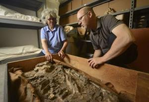 Undated handout photo of Dr. Monge and Dr. Hafford looking at a 6,500-year-old human skeleton, discovered in the basement of the Penn Museum in Philadelphia