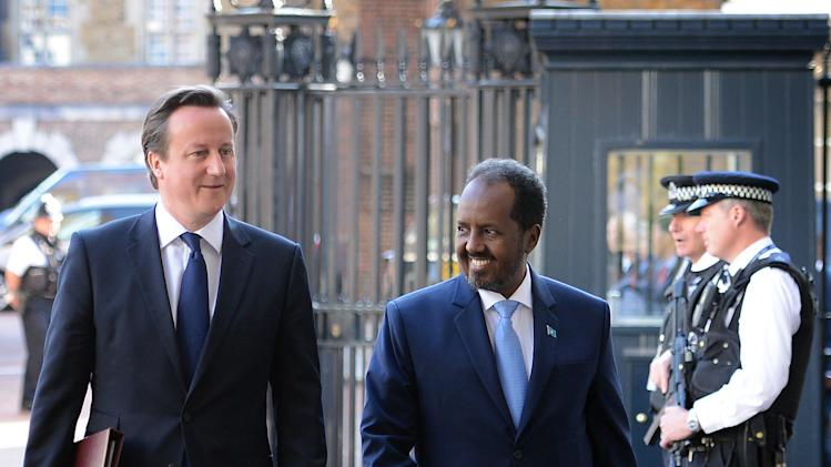 Britain's Prime Minister David Cameron and the President of Somalia Hassan Sheikh Mohamud, right, ahead of the Somalia Conference later in the day. British Prime Minister David Cameron is welcoming Somalia's president and a host of international leaders to London for a conference aimed at securing support for the government in Mogadishu after two decades of conflict. (AP Photo/Stefan Rousseau, Pool)