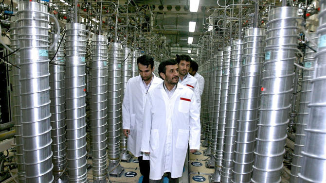 FILE -  In this April 8, 2008 file photo provided by the Iranian President's Office, Iranian President Mahmoud Ahmadinejad, center, visits the Natanz Uranium Enrichment Facility some 200 miles (322 kilometers) south of the capital Tehran. Iran is on threshold of boosting output of material that can be turned quickly into weapons-grade uranium at an underground plant that is heavily fortified against attack, diplomats told The Associated Press on Thursday, Nov. 15, 2012. (AP Photo/Iranian President's Office, File) NO SALES