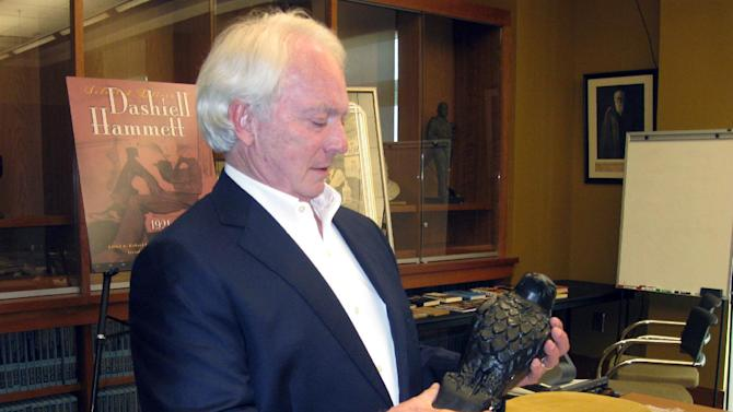 In this May 18 2015 photo, Dashiell Hammett biographer Richard Layman shows a replica of the Maltese Falcon at the University of South Carolina in Columbia, S.C. The university is being given thousands of letters, photos and publications of the late crime fiction author. (AP Photo/Susanne Schafer)