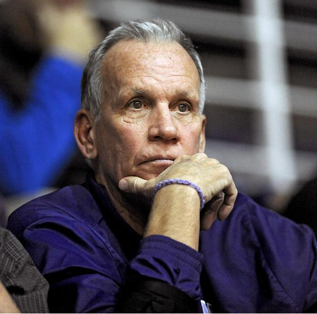 Former NBA player and coach Doug Collins watches his son Northwestern head coach Chris Collins during an NCAA college basketball game between Northwestern and Western Michigan in Evanston, Ill., Satur