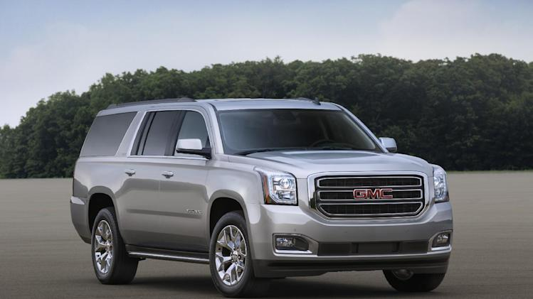 This undated photo provided by General Motors shows the 2015 GMC Yukon XL SLT. General Motors, which sells more SUVs than any other company, is unveiling a redesigned SUV lineup on Wednesday, Sept. 11, 2013. (AP Photo/General Motors)
