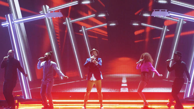 Guy Sebastian representing Australia performs the song 'Tonight Again'  on stage during a dress rehearsal for the final of the Eurovision Song Contest in Austria's capital Vienna, Friday, May 22, 2015. (AP Photo/Kerstin Joensson)