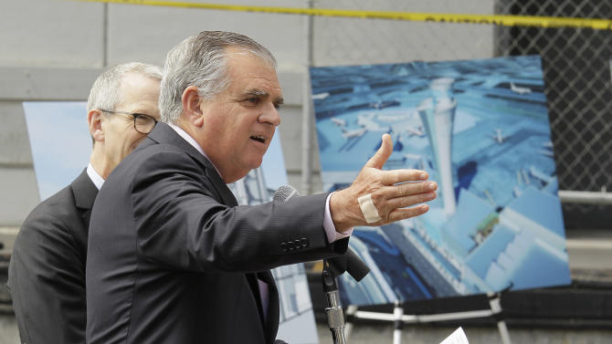 U.S. Transportation Secretary Ray LaHood gestures while speaking during a groundbreaking ceremony for a traffic control tower at San Francisco International Airport  Monday, July 9, 2012 in San Francisco. The airport is getting a new control tower with a unique design that resembles a torch, not the traditional lollipop shape of other towers.  The FAA expects to start using the 221-foot tall facility in 2015. At left is airport director John L. Martin. (AP Photo/Eric Risberg)