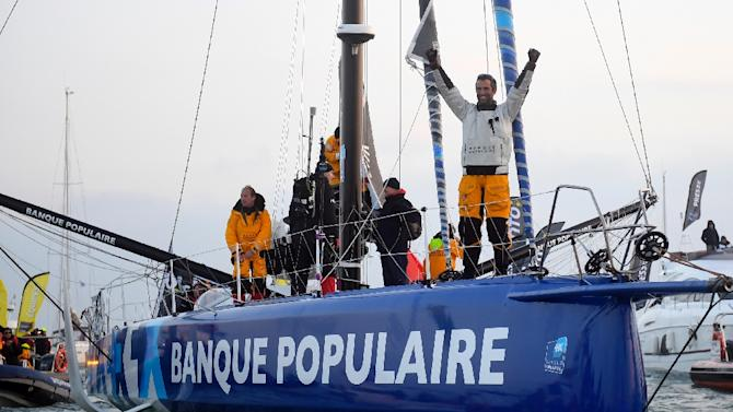 French skipper Armel Le Cleac'h celebrates on his Imoca monohull after crossing the finish line of the Vendee Globe solo around the world sailing race, on January 19, 2017 off Les Sables d'Olonne, western France