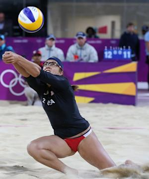 Misty May-Treanor of US reaches for a ball during the Beach Volleyball match against Australia at the 2012 Summer Olympics, Saturday, July 28, 2012, in London. (AP Photo/Petr David Josek)