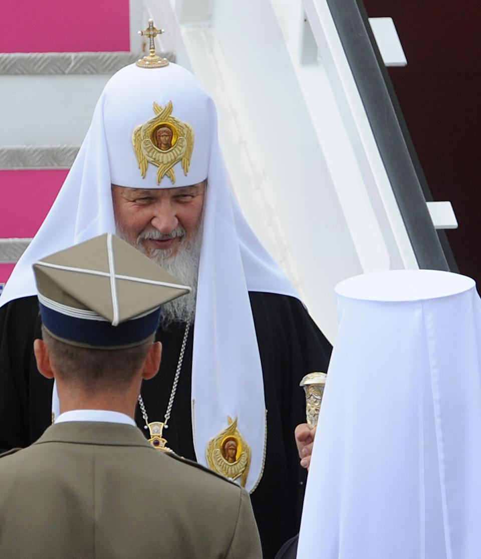 Patriarch Kirill , leader of the Russian Orthodox Church, center, arrives at the Military Airport in Warsaw, Poland, Thursday, Aug. 16, 2012. Patriarch Kirill is in Poland on a four day official visit. (AP Photo/Alik Keplicz)