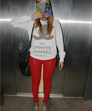 Beyoncé styles up Criminal Damage slogan jumper with red leather