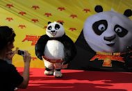 The Panda poses for photographers as it arrives for the premiere of the film &quot;Kung Fu Panda 2&quot; in Berlin on June 7, 2011. DreamWorks Animation, creators of Kung Fu Panda, on Tuesday said it plans to build a $3.2 billion &quot;entertainment zone&quot; in Shanghai, as the US film giant seeks to bolster its presence in the booming Chinese market