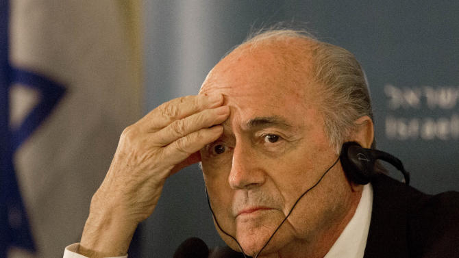 FILE - In this May 19, 2015 file photo FIFA President Sepp Blatter attends a press conference in Jerusalem. Blatter is seeking reelection at the FIFA congress in Zurich where six soccer officials were arrested and detained by Swiss police on Wednesday, May 27, 2015 pending extradition at the request of U.S. authorities after a raid at a luxury hotel. The officials are in Switzerland for the FIFA congress and presidential election.   (AP Photo/Tsafrir Abayov)