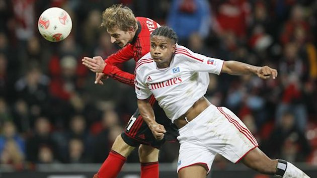 Stefan Kiessling of Bayer Leverkusen and Michael Mancienne of Hamburg (Reuters)