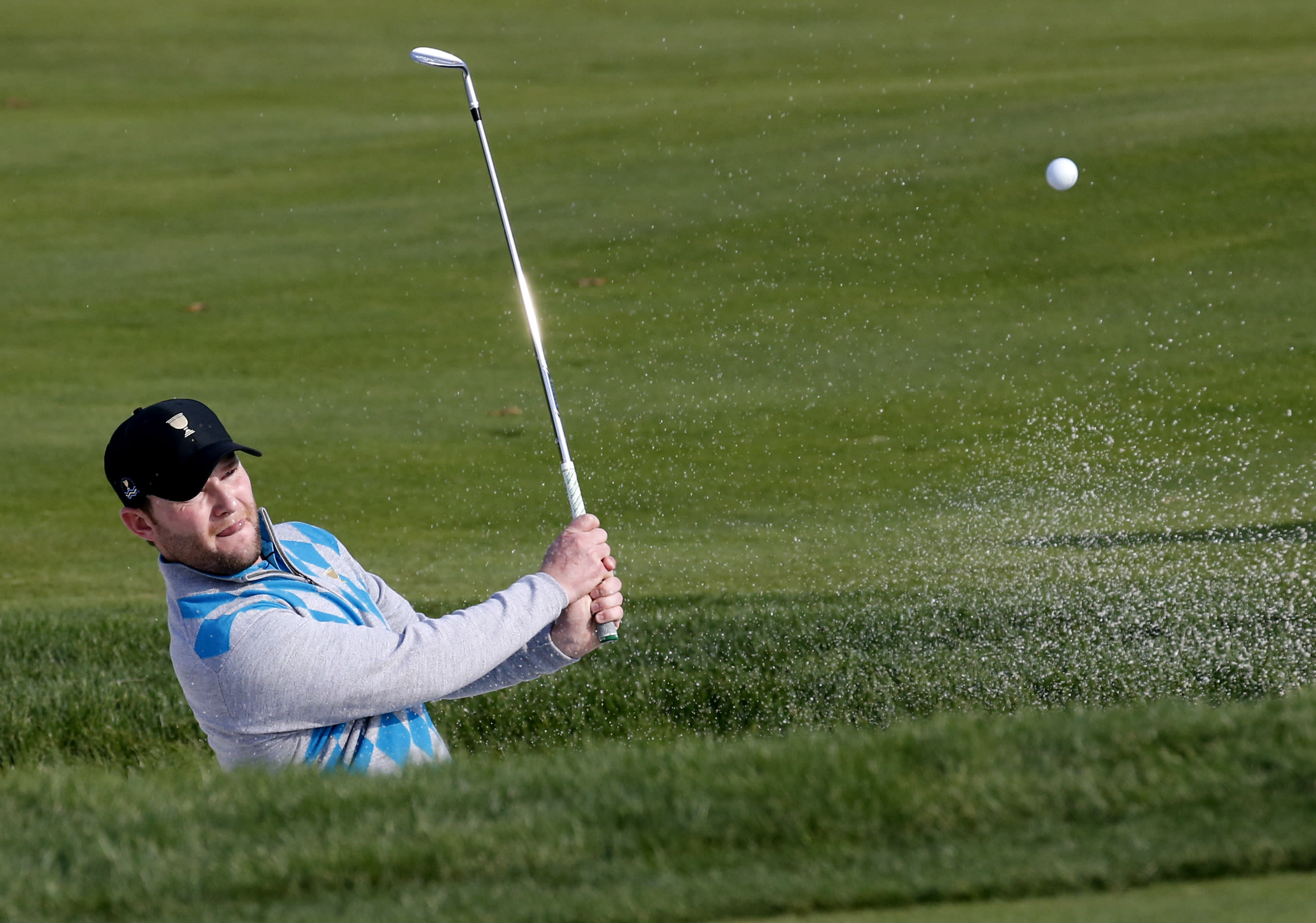 US clings to 1-point lead in Presidents Cup