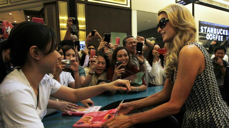 U.S. actress and model Paris Hilton talks to her fans during her visit to Century City Mall in Makati city, metro Manila