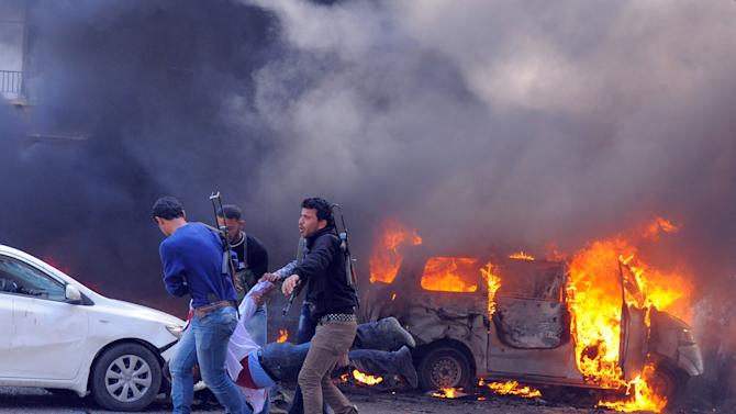 This photo released by the Syrian official news agency SANA shows Syrian security agents carrying a body following a huge explosion that shook central Damascus, Syria, Thursday, Feb. 21, 2013. A car bomb shook central Damascus on Thursday, exploding near the headquarters of the ruling Baath party and the Russian Embassy, eyewitnesses and opposition activists said. (AP Photo/SANA)