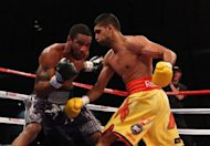 Lamont Peterson (L) and Amir Khan during their WBA Super Lightweight and IBF Junior Welterweight title fight in 2011. Peterson&#39;s camp is &quot;disappointed and distraught&quot; by the decision to cancel a world light-welterweight title showdown next week against Khan after the American failed a drug test