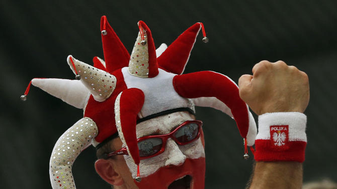 A Polish fan cheers before the Euro 2012 soccer championship Group A match between Czech Republic and Poland in Wroclaw, Poland, Saturday, June 16, 2012. (AP Photo/Petr David Josek)