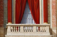 The red curtains on the central balcony of Saint Peter's Basilica, called the Loggia of the Blessings, which is where the new pope will appear after being elected in the conclave, are seen at the Vatican March 12, 2013. Roman Catholic cardinals began their conclave inside the Vatican's Sistine Chapel today to elect a new pope. REUTERS/Eric Gaillard