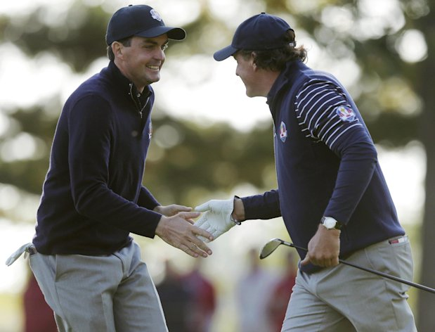 USA's Phil Mickelson, right, and Keegan Bradley react on the seventh hole during a foursomes match at the Ryder Cup PGA golf tournament Saturday, Sept. 29, 2012, at the Medinah Country Club in Medinah, Ill. (AP Photo/Charlie Riedel)