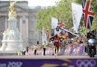 Uganda&#39;s Stephen Kiprotich seconds before crossing the finish line to win the Olympic marathon in London on August 12. Kiprotich stunned a strong Kenyan team to win the men&#39;s Olympic marathon on Sunday, handing his east African nation only their second ever gold medal