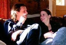 In this undated photo provided by James Coleman, Caitlan Coleman, right, sits with her husband, Josh. Caitlan Coleman's family has broken months of silence over her mysterious disappearance. According to her family, Coleman, an ailing, pregnant American woman missing in Afghanistan with her Canadian husband, was due to deliver in January and needed urgent medical attention for a liver ailment that required regular checkups. The family is making public appeals for the couple's safe return. The Colemans have asked that Josh be identified by his first name only to protect his privacy. (AP Photo)