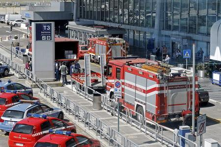 Firefighting trucks are pictured at Terminal 3 of the international Fiumicino airport in Rome