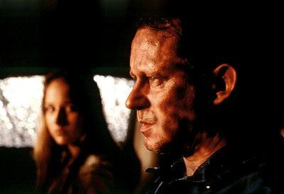 Leelee Sobieski as Ruby and Stellan Skarsgard as her guardian Terry Glass in Columbia's The Glass House