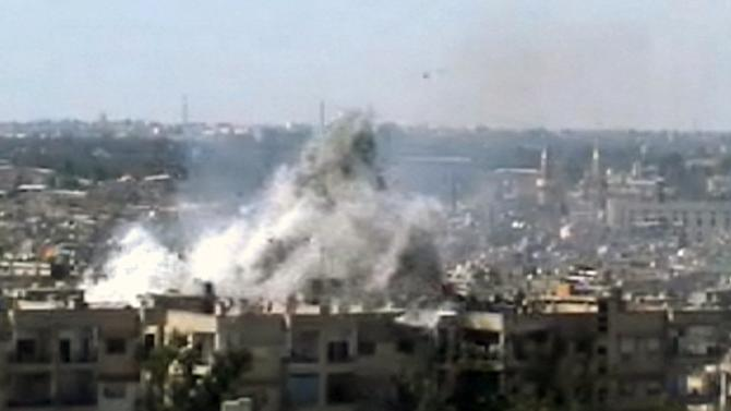 This video image taken from amateur video and broadcast by Bambuser/Homslive shows a series of devastating explosions rocking the central Syrian city of Homs, Syria, Monday, June 11, 2012. Live streaming video caught the devastation during one of the heaviest examples of violence since the uprisings began over a year ago. ( Photo/Bambuser/Homslive via AP video)   MANDATORY CREDIT: BAMBUSER/HOMSLIVE