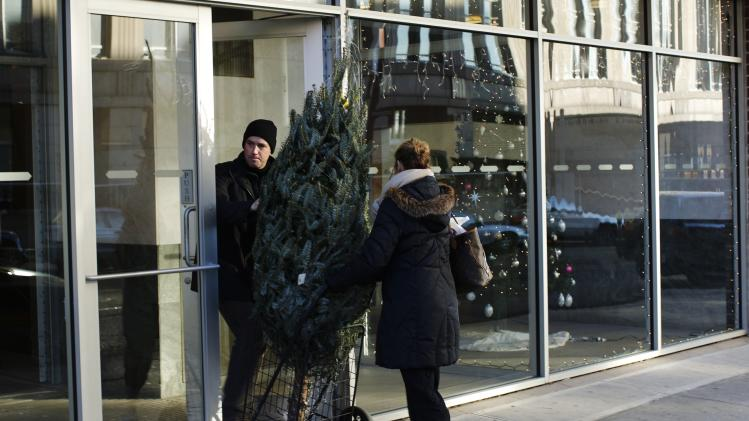 People buy a Christmas tree for decoration in New York