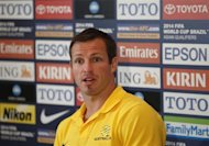 Australia's national soccer team captain Lucas Neill answers a question during a news conference in central Sydney June 17, 2013. REUTERS/Daniel Munoz