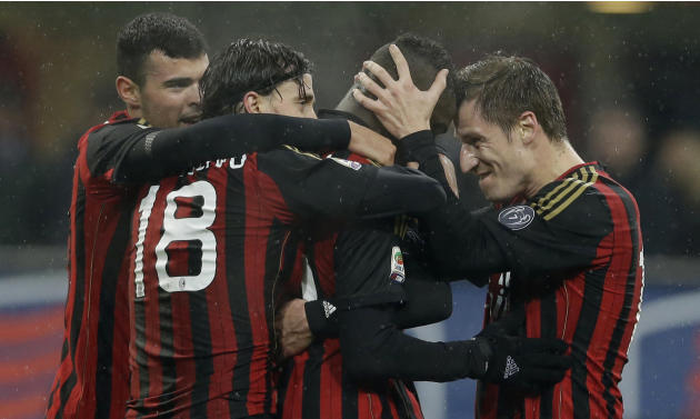 AC Milan forward Mario Balotelli, second from right, celebrates after scoring with his teammate midfielder Riccardo Montolivo, center, AC Milan forward Andrea Petagna, left, and AC Milan Valter Birsa