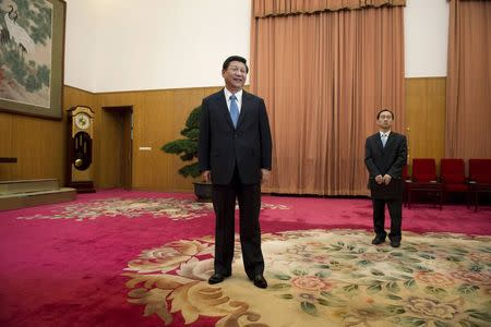 File photo of Xi Jinping waiting to greet former U.S. President Jimmy Carter in room 202 of the Zhongnanhai leadership compound in Beijing