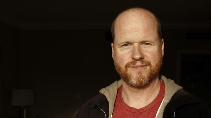 """FILE - In this April 12, 2012 file photo, writer and director Joss Whedon, from the upcoming film """"The Avengers"""", poses for a portrait in Beverly Hills, Calif. The film will be released in theaters May 4. Whedon, the writer-director behind this summer's superhero sensation """"The Avengers,"""" has unveiled a passion project at the Toronto International Film Festival _ his adaptation of Shakespeare's """"Much Ado About Nothing."""" (AP Photo/Matt Sayles, file)"""