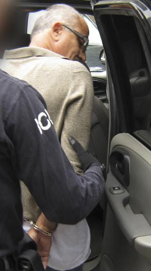 In this photo provided by ICE Homeland Security Investigations, Edin Sakoc is arrested in Burlington, Vt. on Friday, July 26, 2013. Federal authorities in Vermont say Sakoc faces charges of lying to immigration authorities by denying involvement in war crimes during the conflict in Bosnia two decades ago. Authorities say Sakoc lied when he applied for refugee status and for permanent residence in the United States by denying any past crimes of persecution. An indictment says Sakoc, a Bosnian Muslim, committed war crimes against a civilian Bosnian Serb family. He's accused of raping a Serb woman, aiding in the killing of two elderly people she was caring for and burning down the house they were staying in. (AP Photo/ ICE Homeland Security Investigations)