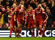 Liverpool&#39;s English midfielder Steven Gerrard (3rd L) celebrates scoring during the English Premier League football match between Liverpool and Everton at Anfield in Liverpool. Gerrard scored all three goals as Liverpool won 3-0