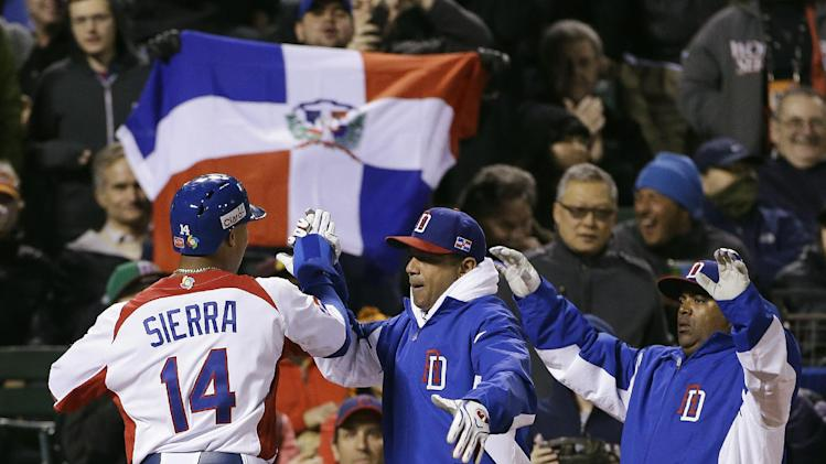 Dominican Republic's Moises Sierra (14) celebrates after scoring during the fifth inning of a semifinal game of the World Baseball Classic against the Netherlands in San Francisco, Monday, March 18, 2013. (AP Photo/Eric Risberg)