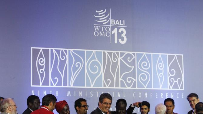 Director-General Azevedo gives a thumbs-up as he greets delegates after the closing ceremony of the ninth WTO Ministerial Conference in Nusa Dua