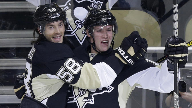 Pittsburgh Penguins' Beau Bennett (19) celebrates his goal with Kris Letang (58) during the first period against the New York Islanders in Game 1 of an NHL hockey Stanley Cup first-round playoff series, Wednesday, May 1, 2013, in Pittsburgh. (AP Photo/Gene J. Puskar)