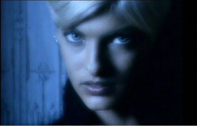 THEN: Linda Evangelista, who had short blond hair at the time, was one of the first models to appear in the video. She sits in a lonely hallway and lip-synchs the words to the song.