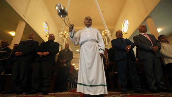 Iraqi Christians attend a mass at Sacred Heart Catholic Church in Baghdad