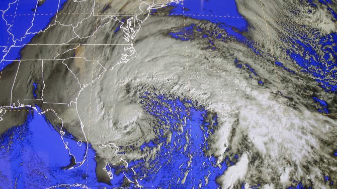 A satellite image of Sandy is shown at the National Hurricane Center in Miami, Saturday, Oct. 27, 2012. Early Saturday, the storm was about 335 miles southeast of Charleston, S.C. Tropical storm warnings were issued for parts of Florida's East Coast, along with parts of coastal North and South Carolina and the Bahamas. Tropical storm watches were issued for coastal Georgia and parts of South Carolina, along with parts of Florida and Bermuda. Sandy is projected to hit the Atlantic Coast early Tuesday. (AP Photo/Alan Diaz)