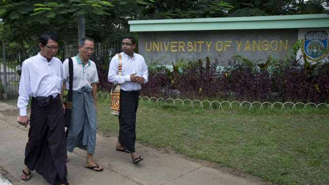 In this picture taken on Wednesday, Nov. 14, 2012, student leaders of a successive uprising, from left, Zaw Zaw Min, Hla Shwe, and Ragu Ne Myint walk outside the main gate of the University of Yangon, where President Barack Obama is scheduled to deliver a speech on Monday, Nov. 19, 2012 in Yangon, Myanmar. Since colonial times, the fight for change in Myanmar has begun on this leafy campus. It was a center of the struggle for independence against Britain and served as a launching point for pro-democracy protests in 1962, 1974, 1988 and 1996. For many, the school has today become a symbol of the country's ruined education system and a monument to a half century of misrule. (AP Photo/Gemunu Amarasinghe)