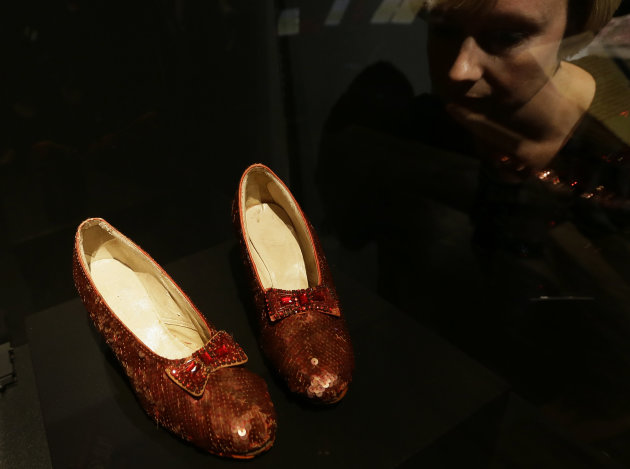 One of the four original pairs of &#39;Ruby Slippers&#39; worn by Judy Garland playing Dorothy from the iconic 1939 Wizard of Oz film on view at the Hollywood Costume exhibition at the Victoria and Albert Museum in London, Tuesday, Oct. 16, 2012. The slippers are on loan from the Smithsonian National Museum of American History and are on display till Nov. 18, when they must return to the US, so that they are back in time for the Thanksgiving national holiday. The slippers were designed by MGM studios chief costume designer Adrian, who designed most of the costumes for the Wizard of Oz film. The show at the Victoria and Albert Museum showcases more than one hundred movie costumes from a century of film-making. The exhibition opens to the public on Oct. 20, 2012 and run till 27 Jan. 2013.(AP Photo/Alastair Grant)