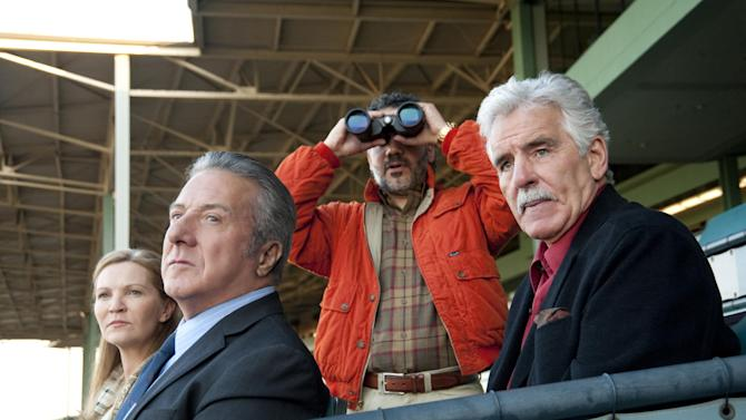 """In this undated image released by HBO, from left, Joan Allen, Dustin Hoffman, John Ortiz and Dennis Farina are shown in a scene from the HBO original series """"Luck."""" A drama set at a California racetrack, HBO canceled the horse racing series after a third horse died during the production of the series. (AP Photo/HBO, Gusmano Cesaretti )"""