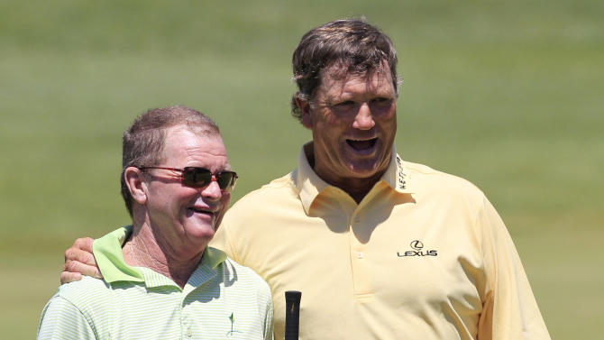 Tom Kite, left, and Peter Jacobsen walk off the 18th green after the first round at the U.S. Senior Open golf tournament at the Indianwood Golf and Country Club in Lake Orion, Mich., Thursday, July 12, 2012. (AP Photo/Carlos Osorio)