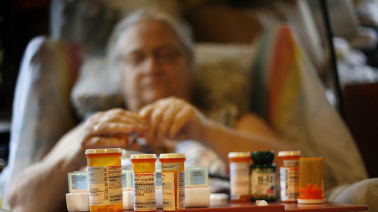 In this Sept. 15, 2011 photo, Judith Odyssey sets up her weekly medication, in Hartford, Maine. Odyssey, who has congestive heart problems, fibromyalgia, asthma and arthritis, gets $674 a month in Social Security. (AP Photo/Robert F. Bukaty)