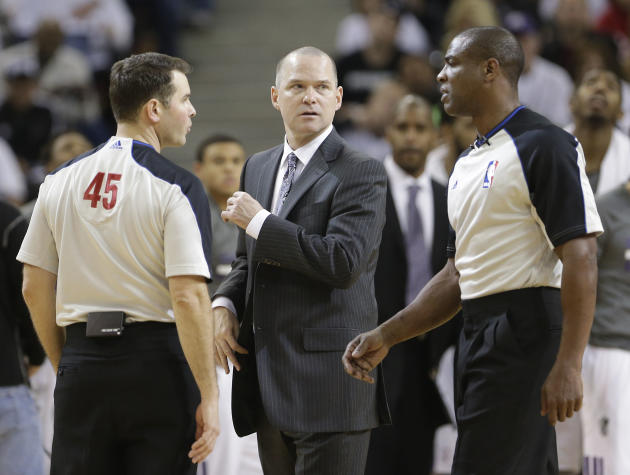 Sacramento Kings head coach Michael Malone talks with Officials Brian Forte, left, and Tony Brown during a timeout in the fourth quarter against the Los Angeles Lakers in a NBA basketball game in Sacr