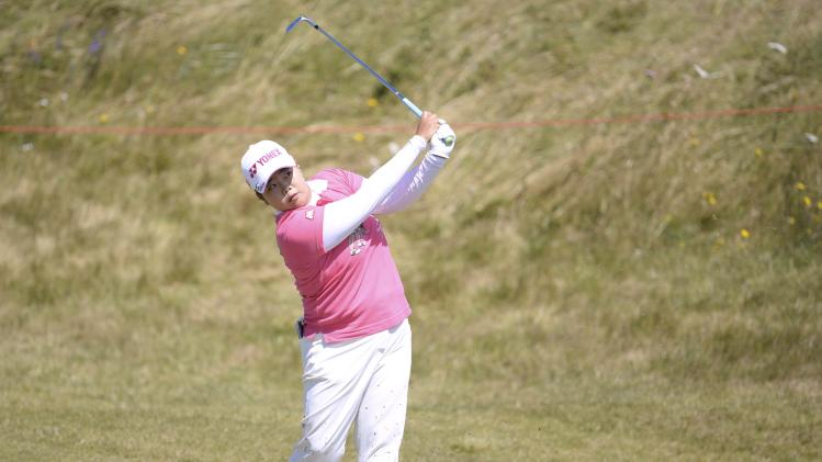 Sun-Ju Ahn of South Korea plays her second shot at the 9th hole during the women's British Open golf tournament at the Royal Birkdale Golf Club in Southport